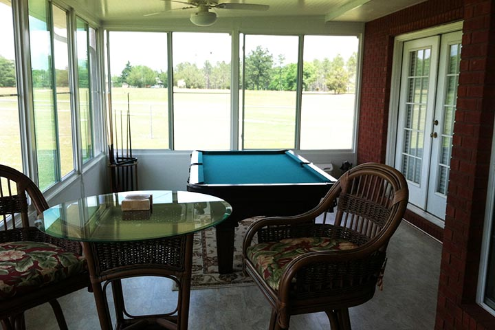 Sunroom That Effectively Extended The House Includins Air Conditioning, A  Pool Table And Enough Space