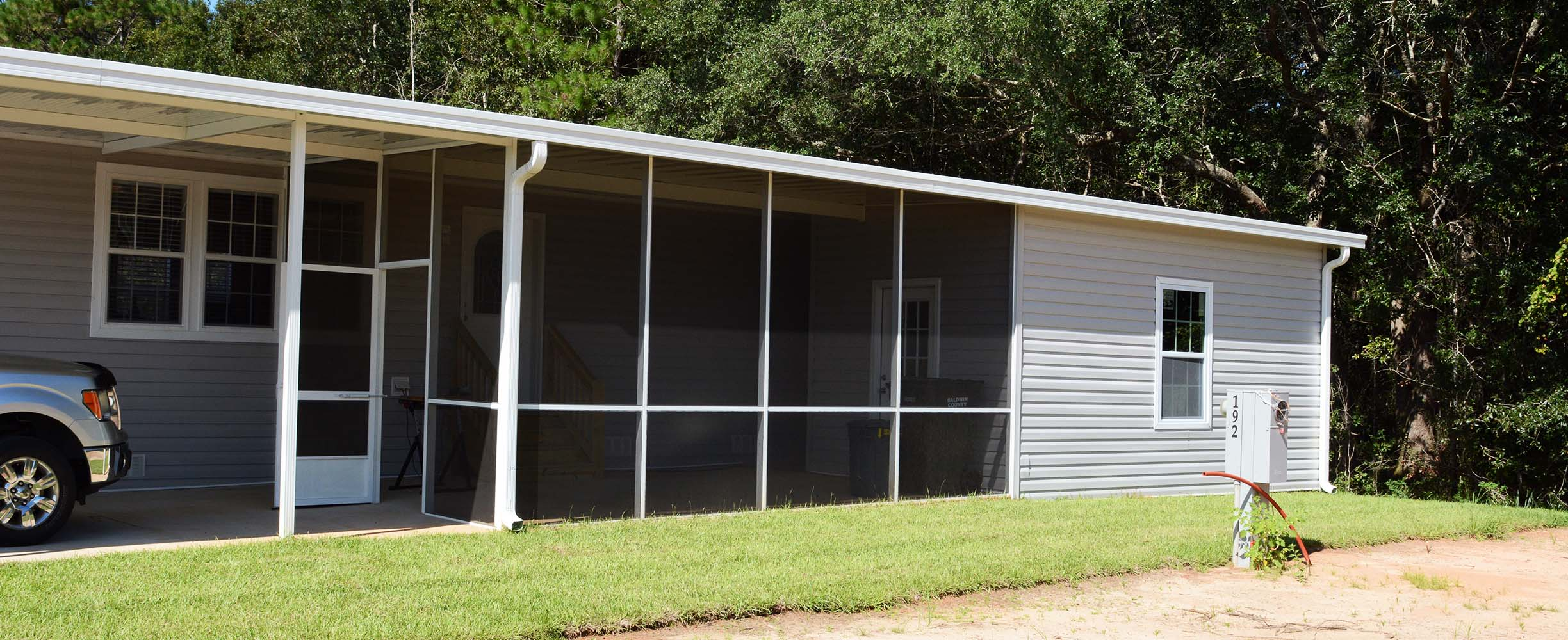 Custom designed and built car port, sunroom and screen room in Foley, Baldwin County, Alabama
